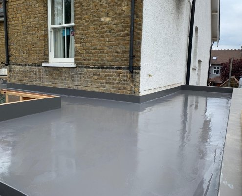 A Flat Roof with a reflective Gray Finish Provided by Prokol's MonoSeal