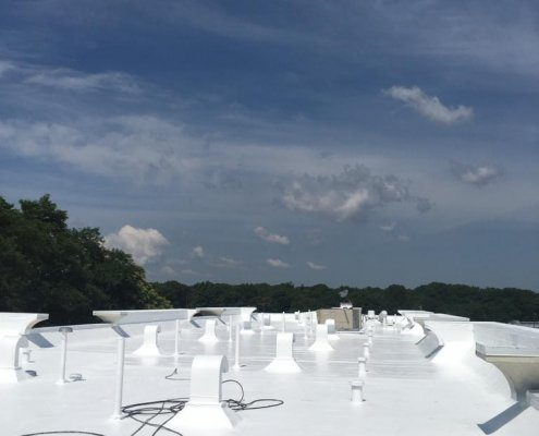 A Flat Roof with a high reflective White Top Coat by Prokol