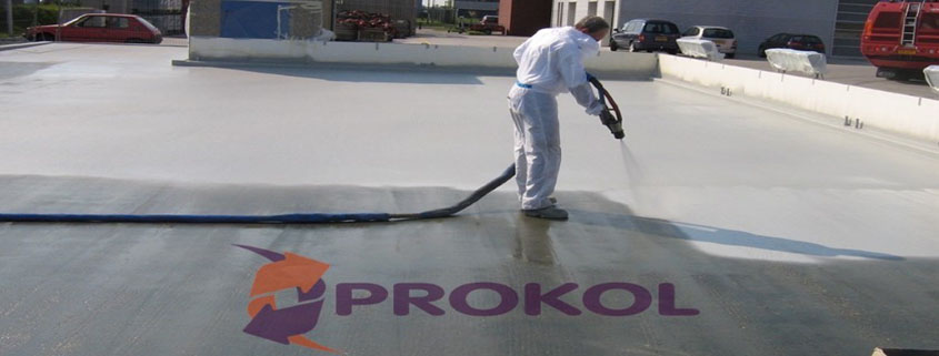 A Roofing Applicator Spraying Prokol Protective Coatings USA's Hotspray Waterproofing and Fire Retardant Products to a roof